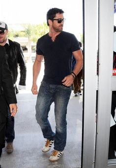 Actor Gerard Butler departing on a flight at LAX airport in Los Angeles, California on June 11, 2014.