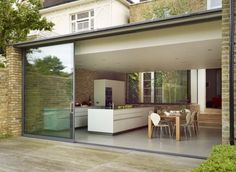 Minimal urban living, bulthaup kitchen by Kitchen Architecture I like the sliding doors makes a change from bifold Glass Extension, Rear Extension, Extension Ideas, Bulthaup Kitchen, House Extensions, Kitchen Extensions, Indoor Outdoor Living, Open Plan Living, Open Plan House