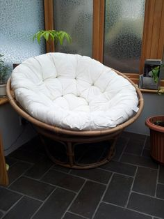 Round wicker chair - perfect for snuggling up on with a great book.