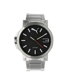 8eedc58ba97 Esse relógio tem pulseira feita em borracha de silicone. A caixa de formato  redondo foi