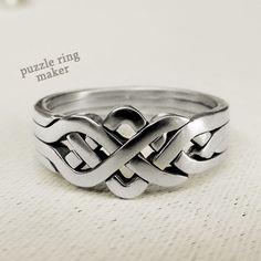 PIONEER - Unique Puzzle Ring by PuzzleRingMaker - Sterling Silver - 4 Band. $65.00, via Etsy.