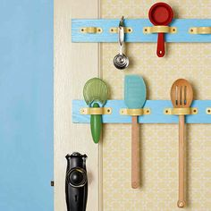 Use pipe straps from your local hardware store to make a cheap and easy utensil holder.