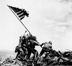 Many believe Joe Rosenthal's image at Iwo Jima was staged, but many argue that if the photo was taken 50 years back, it wouldn't have stirred any controversy.