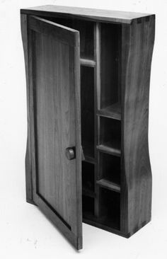 Equivalent to a medicine cabinet in size. Useful for special objects of the  small kind. The deeper center cabinet holds a large television. Drawers and shelves house components. All doors fold against the side of the case for open use. Fine handmade wooden furniture by Joseph van Benten Furnituremakers in Brookline, Massachusetts.