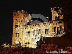 Castle in Treviso city, view from a bridge, castle and river by night, in Treviso, in Veneto, Italy.
