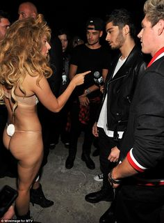 Making friends: Lady Gaga cornered One Direction backstage after her performance and appeared to take a shine to Zayn Malik