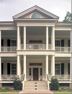 The grand entrance is a study in two-tiered Greek Revival grandeur via my home, my architect