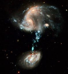 """colliding galaxies resembling a cosmic """"fountain"""" of stars, gas and dust"""