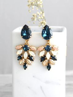 Blue Navy Earrings, Bridal Earrings, Blue Chandeliers, Blue White Opal Chandelier, Dark Blue Champagne Swarovski Bridal Chandelier Earrings  Arrives in our signature Petite Delights by Ilona Rubin® Box. Sent By Registered Insured international mail. Petite delights® design . Petite Delights® By Ilona Rubin is an Official SWAROVSKI® Branding Partner Official Swarovski Elements® Partner Made with real genuine high quality Austrian Swarovski ©Crystal . Our brand is legally licensed & authori...