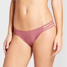 Bring on the beach in flirty style as you slip on these Strappy Cheeky Bikini Bottoms from Xhilaration™. These cute bikini bottoms let you show off your girly-meets-flirty side with a rosy-pink hue, strappy sides and an extra-cheeky cut. An elastic at the leg opening offers flexibility and ease of movement — perfect for all the sunny adventures you have planned throughout the summer. Pair with a coordinating bikini top or mix and match with other pieces in your wardrobe for...