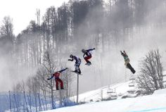 Gold medalist Pierre Vaultier of France, left, leads, from second left to right, silver medalist Nikolai Olyunin of Russia, Paul Henri de le Rue of France, and bronze medalist Alex Deibold of the United States in the men's snowboard cross final at the Rosa Khutor Extreme Park at the Sochi Winter Olympics in Russia.