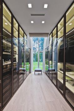 Glass enclosed closet doors provide an element of sophistication. The LED lighting draws inspiration to the clothes at any time of day.