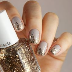 "Elegant holiday nails featuring ""Summit of Style"" and ""Take it Outside"" from Essie 