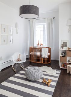 white and grey scandinavian baby's room