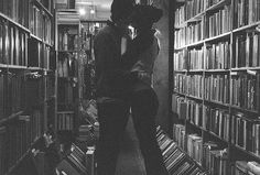kisses surrounded by books