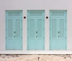 Aquamarine Shuttered Doors ~ Alys Beach, Florida ~ via Italian Girl in Georgia: White Stucco and Painted Shutters, Sea Breezes and Palm Trees ~ Original Colour Photograph by Suzanne MacCrone Rogers
