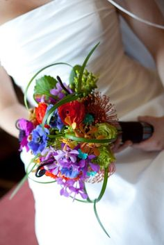 Bright colourful bouquetl. Hot pink, purple, green, orange, and more. Bold & Textural Wedding Flowers, Denver, Colorado