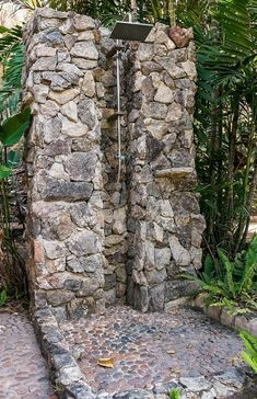 Discover a private place of paradise to clean up with the top 60 best outdoor shower ideas. Explore cool open and privacy enclosure designs. Outdoor Pool Shower, Outdoor Shower Enclosure, Indoor Outdoor Living, Outdoor Spaces, Rock Shower, Outside Showers, Garden Shower, Outdoor Bathrooms, Beach Bungalows