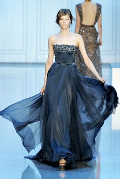 Elie Saab F 2011: Beautiful dark blue color! The chiffon flows perfectly down the runway! The embellishments adds glamour