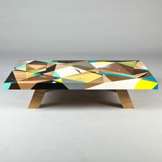 "Graffiti-Inspired Coffee Tables by Vans the OmegaVans the Omega is a letterform artist recognized in the global graffiti scene who's turned his eye to furniture. Inspired by ""ancient scripts, architecture, engineering, nature and the idea of movement or balance"", his inspirations meld together in these bright, angular coffee tables. In this set of four limited edition coffee tables, he mixes geometric forms with bright colors and patterns to create a unique look unlike any other."