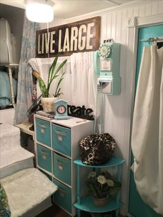 The Martha Stewart storage hold clothes, towels, shoes and under garments that are easily accessible. The old phone came from HSN.