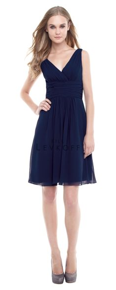 Chiffon dress with a V-front and back. Pleats adorn the bodice with a ruched cummerbund at the natural waist. Soft gathers embellish the skirt with overlay draped effect.