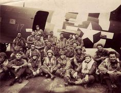 Chalk 17 poses for a photograph before departing for Normandy. This image shows the paratroopers and air crewmen of Pathfinder Team #2 of the 508th Parachute Infantry Regiment/82nd Airborne Division on the evening of Monday June 5 1944 shortly before taking off to go to France. They are posing in front of aircraft #42-93096 a Douglas C-47A that is in the collection of The National WWII Museum.