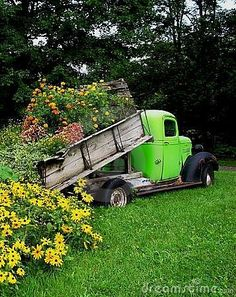 Dump truck planter. Great use for your old broken down trailer when you buy a new Kaufman one!