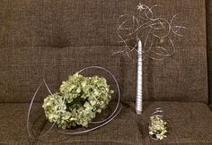 Wire bouquet with silver metallic candle and charms, and boutonniere and centerpiece with dried antique hydrangeas