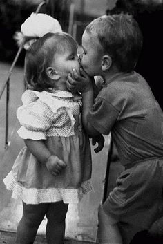 a four year old kisses with more passion than most adults-- tooo cute