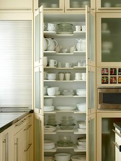New Kitchen Storage Ideas Tall storage cupboard, cabinet holds lots of things in the kitchen. Could be used as a pantry as well. from BHG - Own Kitchen Pantry Tall Storage Cupboard, Dish Storage, Smart Storage, Plate Storage, Plate Shelves, Cabinet Storage, Pantry Storage, Cabinet Ideas, Cabinet Doors