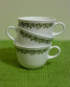crazy daisy corelle teacups and saucers! ---- I have 3 tea cups and 4 saucers, but I would like a set of 8. So I need 5 cups and 4 more saucers.