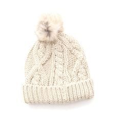 This knit hat features a luxuriously cute, rabbit fur pom-pom, making it one of our favorite, albeit old-school, winter essentials.