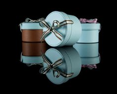 Love a great hat box and these are great looking.  The fancy bows wouldn't last long in my closet, that's for sure.  These are actually mini ones you get with jewelery at Bohrunga USA store.
