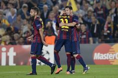 Barcelona's Argentinian forward Lionel Messi (R) is congratulated by his teammate Brazilian forward Neymar da Silva Santos Junior after scoring during the UEFA Champions League football match FC Barcelona vs Ajax Amsterdam at the Camp Nou stadium in Barcelona on October 21, 2014.