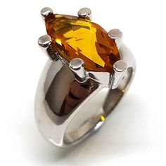 A gemstone ring for us bigger girls. A large marquise shape yellow color citrine gem set in a chunky 925 silver band is best suited to larger fingers. Citrine Ring, Citrine Gemstone, Gemstone Engagement Rings, Gemstone Rings, 13th Anniversary, Prong Set, Solitaire Ring, Semi Precious Gemstones, Jewelry Branding