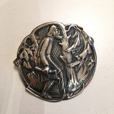 Gustav Gaudernack design for own workshop. Silver brooch with motif from viking saga. Skier in witrer wood. Silver Brooch, Saga, Vikings, Workshop, Models, Wood, Design, Role Models, Atelier