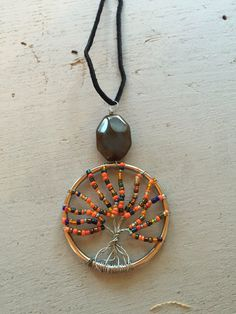 A personal favorite from my Etsy shop https://www.etsy.com/listing/462878590/2-wire-wrapped-tree-of-life-necklace