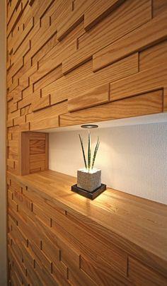 凹凸のある木製タイルが、光の当たり具合によって様々な表情をみせます。