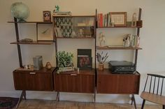 This is a beautiful 3 bay wall unit made by Blindheim Møbelfabrikk ERGO from Norway. It has 4 boxes, 4 shelves, and one double deep desk shelf (not pictured but included). It has high heeled feet...