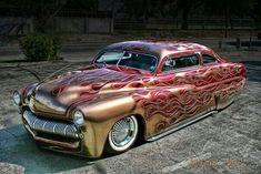 Kustom Merc with gold flames over a red base and slammed to the ground. Custom Paint Jobs, Custom Cars, Classic Hot Rod, Classic Cars, Lead Sled, Kustom Kulture, Us Cars, Race Cars, Sweet Cars