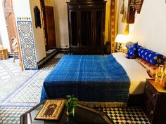 One of the two ground-level salons of Riad Idrissy has been turned into a comfortable guest room, complete with a combination of Moroccan/African furnishings. The other remains a common area, lined with couches and tables.