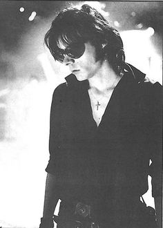 He ... sisters of mercy ...Andrew Eldrich was so hot back in the day <3