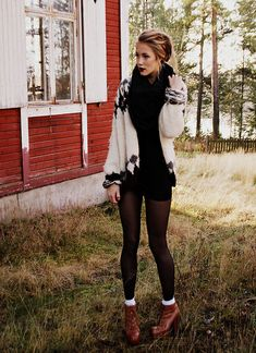 love the layering on top with the tights on bottom...although skirt instead of shorts