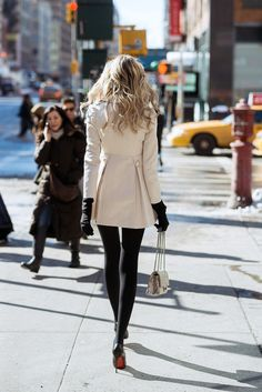 beautifully detailed cream coat over black leggings/gloves....love the ladylike bag & Louboutins too