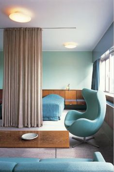The Comtemporist's Room Divider - Drapery.  Color chair #arnejacobsen