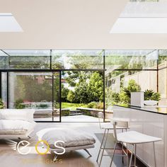By creating full walls of slim framed sliding glass doors the division between inside and out is blurred, even when these large format patio doors are closed. #sligingdoors #glassdoors #aluminiumslidingdoors #eosrooflights