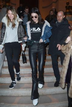 January 24, 2017 In a FILA tee, denim shearling, Unravel Project leather flared pants, WGACA Vintage Chanel leather fanny pack, white boots and Krewe sunglasses while out in Paris.
