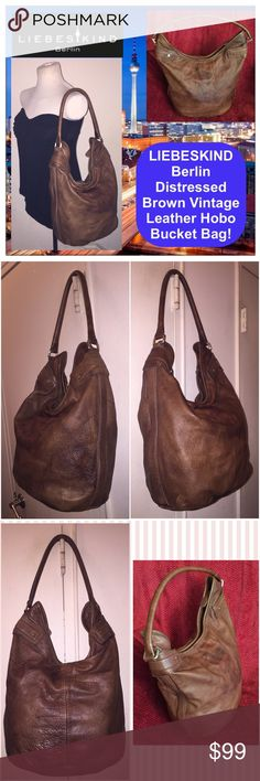 """LIEBESKIND Berlin Distressed Leather Bucket Bag! LIEBESKIND Berlin Distressed Brown Leather Hobo Bucket Bag! Features: large size, 100% authentic, brown distressed vintage leather, top zip closure, rolled leather shoulder strap, """"Liebeskind Berlin"""" leather embossed on the front, 3 int slip pockets & 1 into zip pocket & plaid lining. Measures 15 1/2"""" high (side), 11 1/2"""" high (mid) x 14 1/2"""" across x 7 1/2"""" wide (oval bottom) with 13"""" shoulder clearance. Some int marks marks & variations on…"""