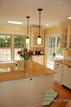 Like the background cabinet with the glass doors above. Stratford-Ivory-Cream by Chester County Kitchen & Bath, via Flickr